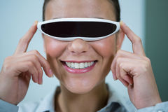 Woman using virtual video glasses. In optical store Stock Photography