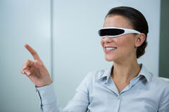 Woman using virtual video glasses. In optical store Stock Image