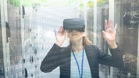 Woman using VR with binary code. Businesswoman using VR in Server Room against animated binary code backrgound stock footage