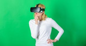 Woman using VR device. Person with virtual reality helmet isolated on green background. Virtual reality poster. Woman using VR device. Person with virtual stock image