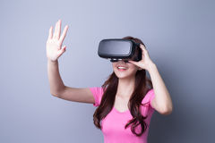 Woman using VR headset glasses Stock Photo