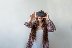 Woman using VR headset Royalty Free Stock Photos