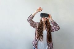 Woman using VR headset Stock Image