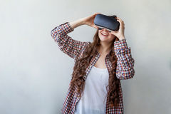 Woman using VR headset Stock Photos