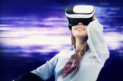 Woman using VR virtual reality glasses Stock Images