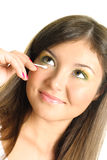 Woman using a wadded stick. Beautiful young brunette woman removing makeup with a wadded stick Royalty Free Stock Photo