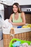 Woman using washing machine Royalty Free Stock Photo