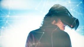 Woman using wearable vr technology headset, digital cyber virtual world stock photography