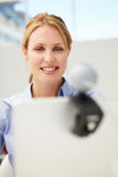 Woman using webcam. Businesswoman using webcam in office Royalty Free Stock Photos