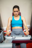 Woman using weights machine Royalty Free Stock Image
