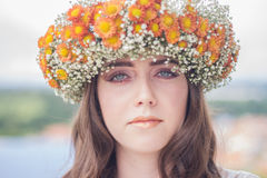 Woman Using White and Orange Floral Hat Stock Image