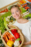 Woman using wicker basket to carry vegetables Royalty Free Stock Images