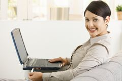Woman using wireless network at home Royalty Free Stock Photography