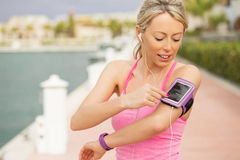 Woman using workout app on her smartphone Stock Photo
