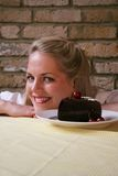 Woman v Cherry Chocolate Cake - Temptation. Image of a smiling blond woman thinking about eating a chocolate cake stock photos