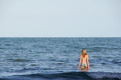 Woman on Vacation. Woman in bikini going for a swim at beach Stock Image
