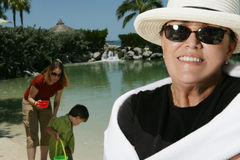 Woman on Vacation. A portrait of a smiling woman on a vacation in Florida with another woman and her son Stock Image