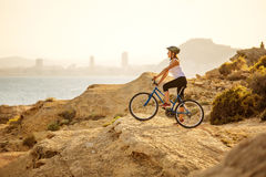 Woman on vacation biking at beach Royalty Free Stock Images