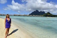 Woman on vacation in Bora bora Stock Photos