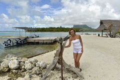 Woman on vacation in Bora bora Stock Images