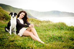 Woman vacation with dog Stock Images