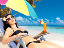 Woman on vacation enjoying at beach Royalty Free Stock Photos