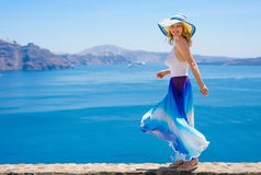 Woman on vacation in Mediterranean. In hat and dress Royalty Free Stock Photo