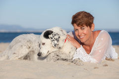 Woman on vacation with pet dog Stock Image