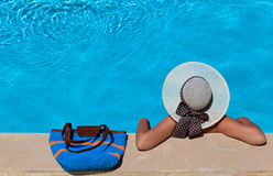 Woman on vacation by the pool Stock Photos