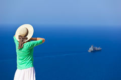 Woman on vacation at the sea Stock Photos