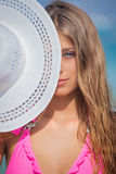 Woman on vacation with sunhat Royalty Free Stock Image