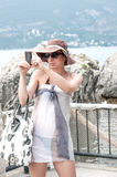 Woman on vacation taking photo Royalty Free Stock Photography