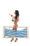 Woman on vacation to the beach. Woman carrying beach chair and other attributes during vacation Stock Image