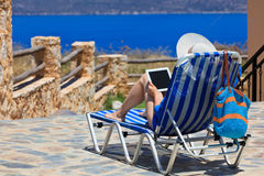 Woman on vacation with touch pad Stock Images