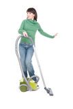 Woman with vacuum. Young adult woman with vacuum over white background Stock Image