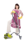 Woman with vacuum. Young adult woman with vacuum over white background Stock Photos