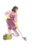 Woman with vacuum. Young adult brunette woman with vacuum. over white background stock photo