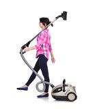 Woman with vacuum cleaner Stock Photo