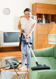 Woman with vacuum cleaner Royalty Free Stock Images