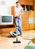 Woman with vacuum cleaner Stock Image