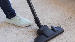 Woman with vacuum cleaner cleaning carpet at home. People, housework and housekeeping concept - woman with vacuum cleaner cleaning carpet at home stock video footage