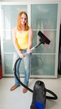 Woman  with the Vacuum Cleaner Stock Images