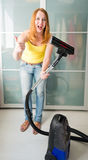 Woman  with the Vacuum Cleaner Royalty Free Stock Photography