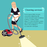 Woman with a vacuum cleaner Stock Image