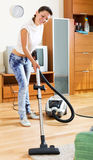 Woman with vacuum cleaner Royalty Free Stock Image