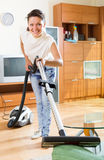 Woman with vacuum cleaner Royalty Free Stock Photo