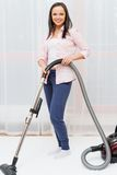 Woman vacuum cleaning carpet Royalty Free Stock Images