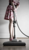 Woman vacuuming. Woman cleaning the house with vacuum cleaner Royalty Free Stock Photo