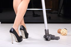 Woman vacuuming Stock Photos
