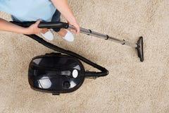 Woman Vacuuming Carpet Stock Image